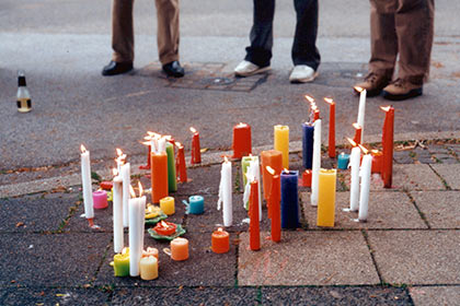 candles burning on the ground